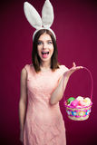 Woman with an Easter egg basket Stock Image