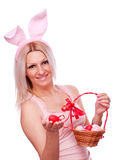 Woman with Easter eggs and ears Stock Images