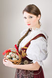 Woman with Easter eggs in traditional folk clothes Stock Photos