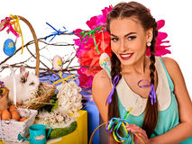 Woman in easter style holding bunny and flowers. Easter girl holding bunny and eggs. Holiday style holding and group of rabbits in basket with flowers. Isolated Royalty Free Stock Images
