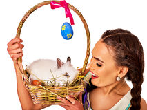Woman in easter style holding eggs and flowers. Stock Photo