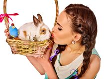 Woman in easter style holding eggs and flowers. Royalty Free Stock Image