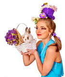Woman in easter style holding eggs and flowers. Stock Photography