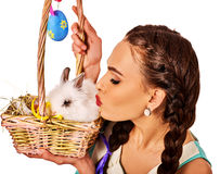 Woman in easter style holding eggs and flowers. Easter girl holding bunny and eggs. Holiday style holding and group of rabbits in basket with flowers. Woman Stock Images