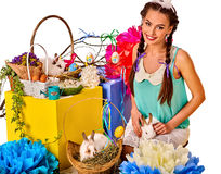 Woman in easter style holding eggs and flowers. Easter girl holding bunny and eggs. Holiday style holding and group of rabbits in basket with flowers. White Stock Images