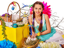Woman in easter style holding eggs and flowers. Royalty Free Stock Photos