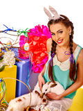 Woman in easter style holding eggs and flowers Royalty Free Stock Photo