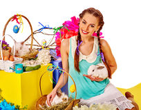Woman in easter style holding eggs and flowers Stock Photography