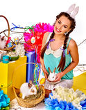 Woman in easter style holding eggs and live rabbit. Stock Photography
