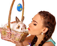 Woman in easter style holding rabbit  basket. Royalty Free Stock Images
