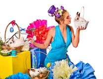 Woman in easter style holding rabbit and flowers in basket. Royalty Free Stock Images