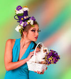Woman in easter style look up with bunny. Stock Photography