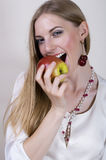 Woman eat apple. Beautiful girl eats an apple Stock Images