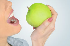 Woman eat apple Royalty Free Stock Photos