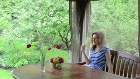 Woman eat apple flower stock footage