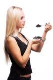 Woman eat black caviar stock image