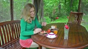 Woman eat breakfast stock footage