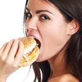 Woman eat burger Stock Images