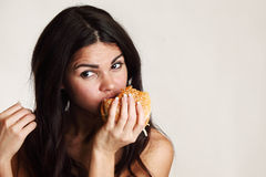Woman eat burger Royalty Free Stock Images
