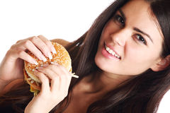Woman eat burger Stock Photos