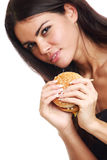 Woman eat burger Royalty Free Stock Image