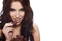 Woman eat a chocolate Stock Photography