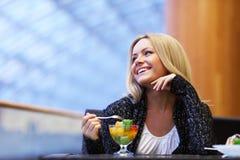 Woman eat desert. In caffe Stock Photo