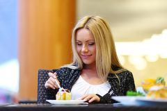 Woman eat desert Stock Images