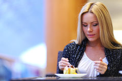 Woman eat desert Royalty Free Stock Photography