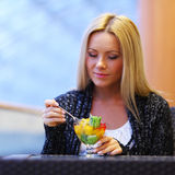 Woman eat desert Stock Images