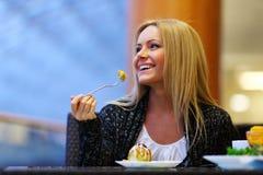 Woman eat desert Stock Image