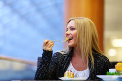 Woman eat desert Stock Photography