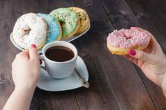 Woman eat donut and drink coffee Stock Photo