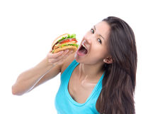 Woman eat fast food unhealthy burger Royalty Free Stock Image