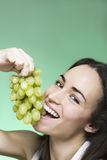 Woman eat grapes Stock Photos