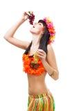 Woman eat grapes wearing bikini made of flowers Royalty Free Stock Photography