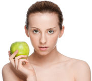 Woman eat green apple Stock Photography