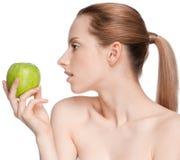 Woman eat green apple Royalty Free Stock Image