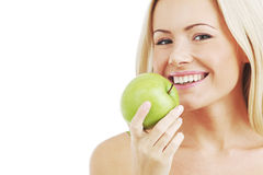Woman eat green apple Royalty Free Stock Images
