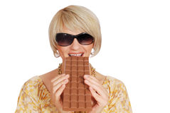 Woman eat large chocolate Royalty Free Stock Photography