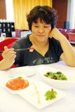 Woman eat meal. Chinese woman eating meal in a restaurant Stock Photo