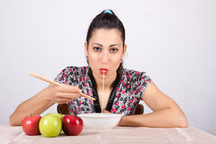Woman eat noodles Royalty Free Stock Image