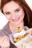 Woman eat oatmeal with dry fruits. Dieting Royalty Free Stock Images