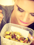 Woman eat oatmeal with dry fruits. Dieting Stock Photos