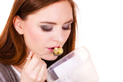 Woman eat oatmeal with dry fruits. Dieting Royalty Free Stock Photography