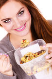 Woman eat oatmeal with dry fruits. Dieting Royalty Free Stock Photos