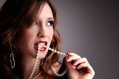 Woman eat pearls Royalty Free Stock Images