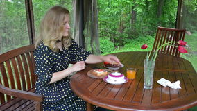 Woman eat sandwich stock video