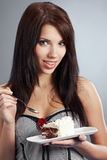 woman eat a slice of a sweet cake royalty free stock images