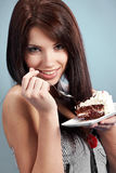 Woman  eat a slice of a sweet cake Stock Photography